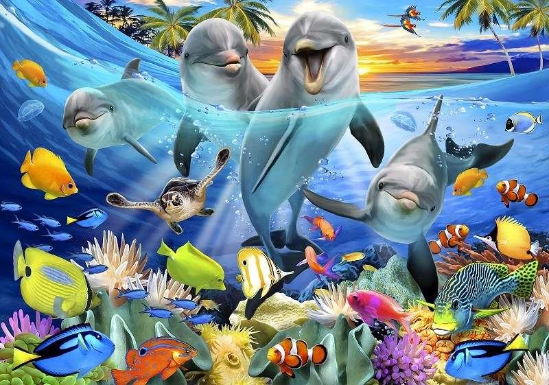 Фототапет в морето със сладките делфини и малките рибки